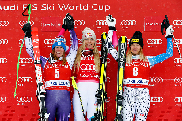 Lindsey Vonn, flanked by Stacey Cook, left, and Julia Mancuso on the podium after the Lake Louise downhill // photo Getty Images