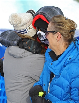Tiger Woods in the ski mask, all incognito-like in a skeleton-patterned ski mask, in the finish area at Cortina d'Ampezzo, Italy // photo Getty Images