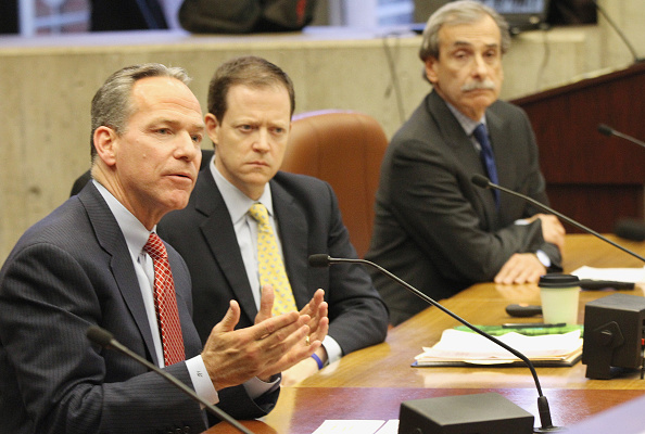 Boston 2024 chair John Fish, left, along with Rich Davey, center, and David Manfredi, right, appear before a hearing at Boston City Hall earlier this month // photo Boston Globe via Getty Images