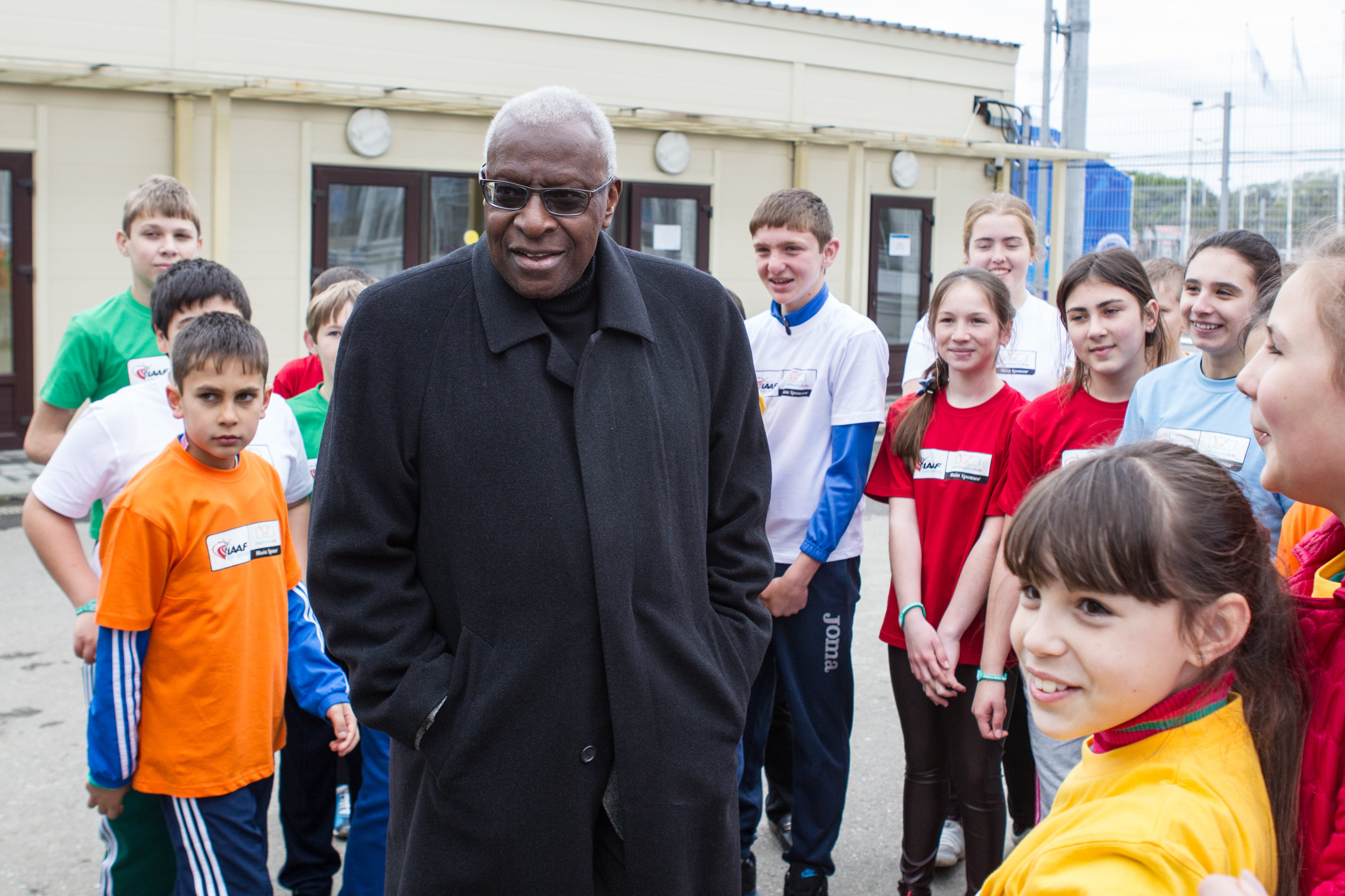IAAF president Lamine Diack meets children before Nestle Kids track and field  demonstration event in Sochi // photo IAAF and Getty Images