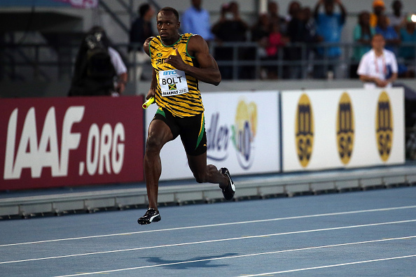 Usain Bolt running Saturday in the World Relays // photo Getty Images