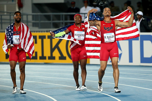 Tyson Gay, left, with Mike Rodgers and Ryan Bailey after winning the men's 4x100 relay // photo Getty Images