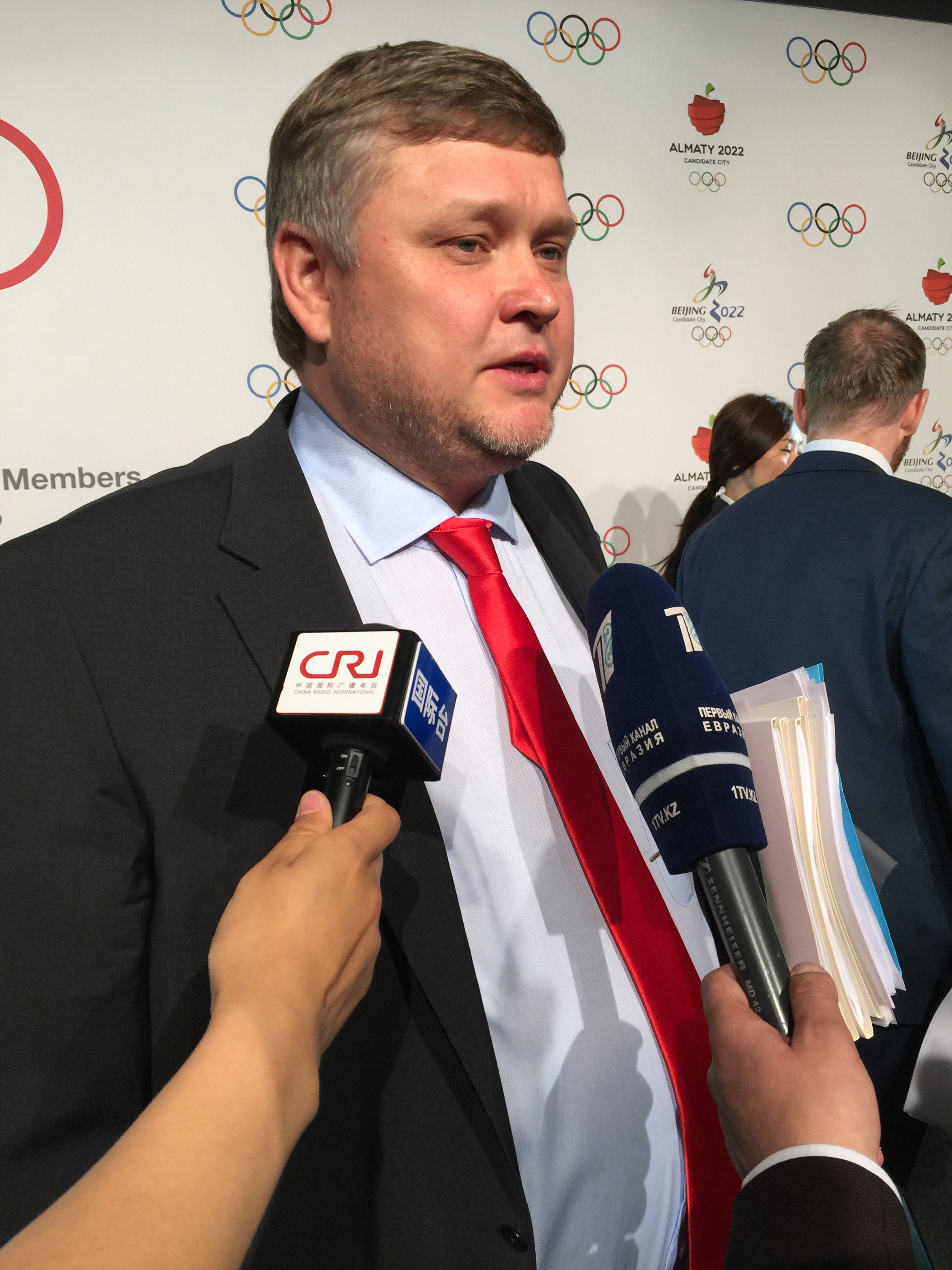 Almaty 2022 vice chairman Andrey Kryukov answers reporters' questions after the bid presentation to IOC members at the Olympic Museum