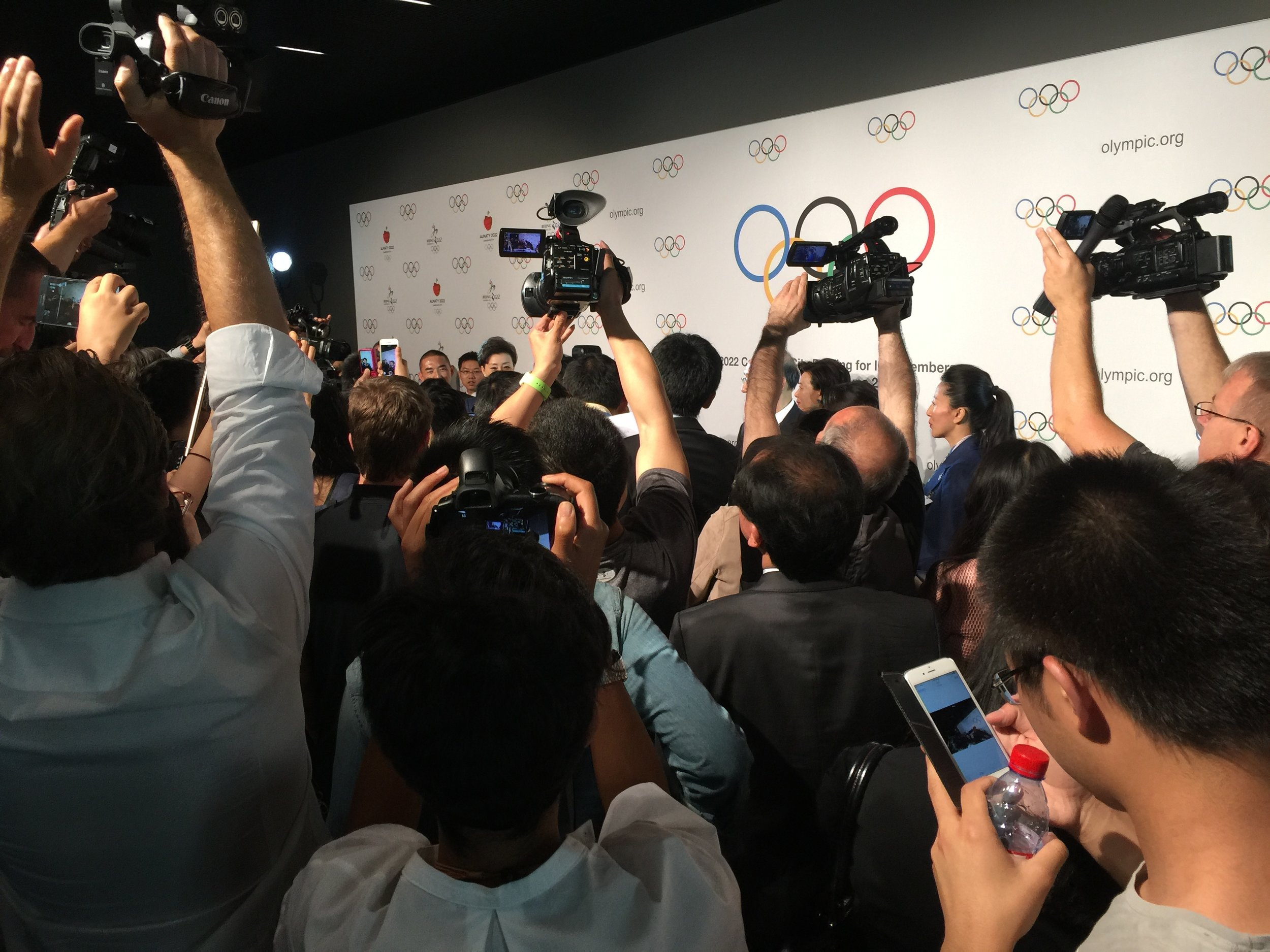 Dozens of reporters and camera crews, most of them Chinese, eagerly awaiting the Beijing 2022 bid team after its presentation to the IOC members at the Olympic Museum