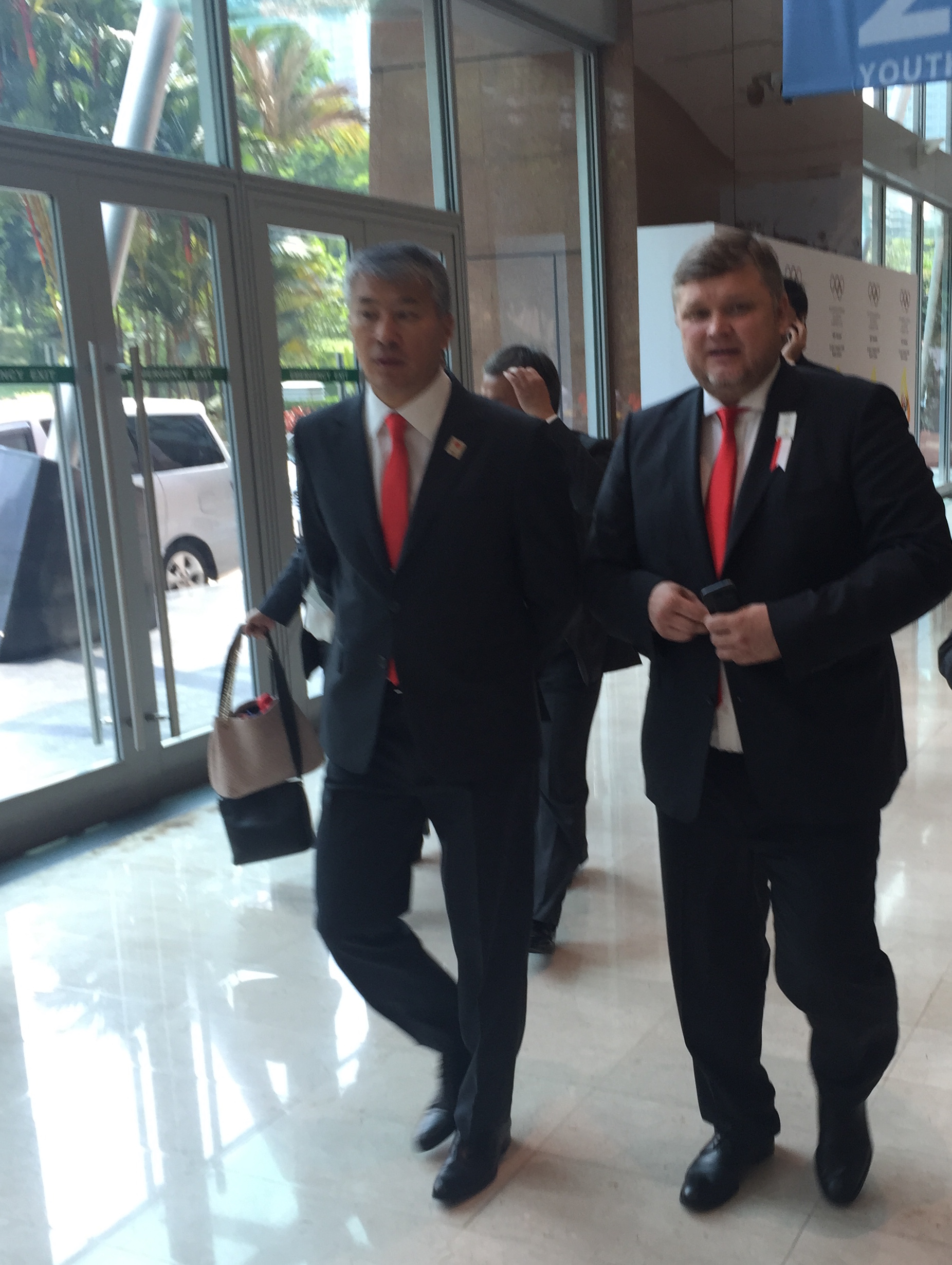Almaty bid leader Andrey Kryukov, right, just moments after the presentation