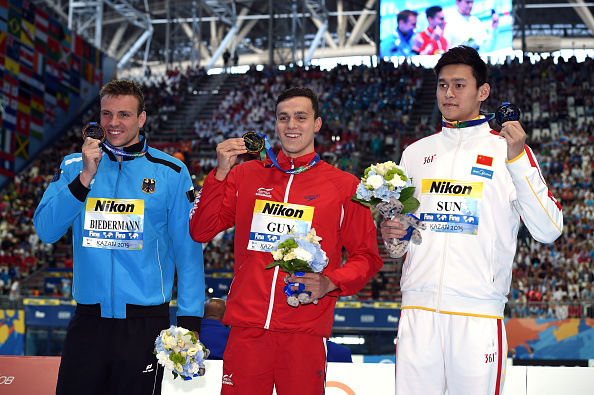 The men's 200 free podium: Paul Biedermann (Germany) left; James Guy (Britain), center; Sun Yang (China), right