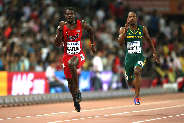 Justin Gatlin cruising to victory in the heats in round one of the men's 100. That's South Africa's Henricho Bruintjies also in the frame, who would finish third in the heat, 24-hundredths  back // Getty Images