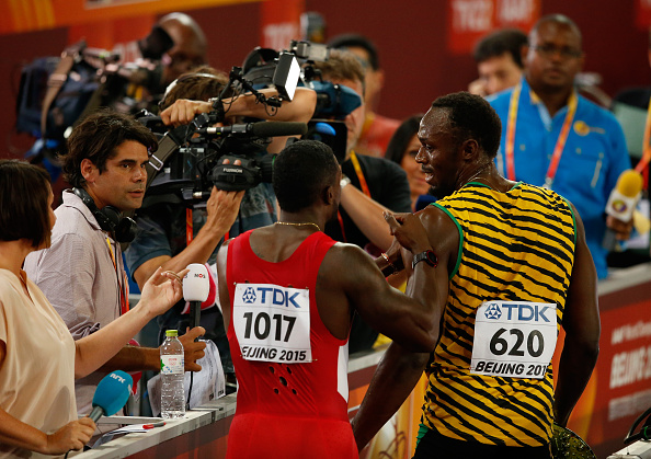 Justin Gatlin and Usain Bolt after round one of the men's 100 // Getty Images