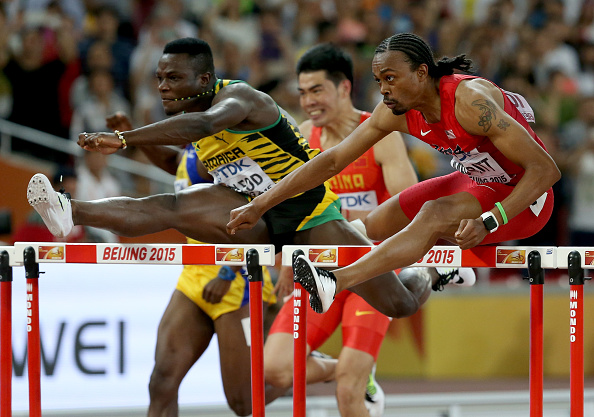 Omar McLeod of Jamaica, left, and  Merritt in the 110 semifinal