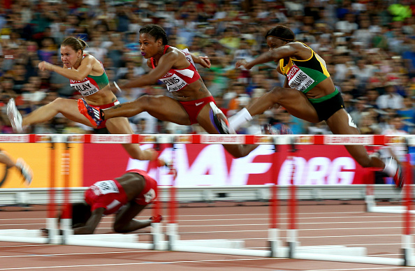 Dawn Harper-Nelson of the United States falls as, left to right, Alina Talay of Belarus, Sharika Nelvis of the United States and Danielle Williams of Jamaica keep on during a women's 100 hurdles  semifinal  // Getty Images