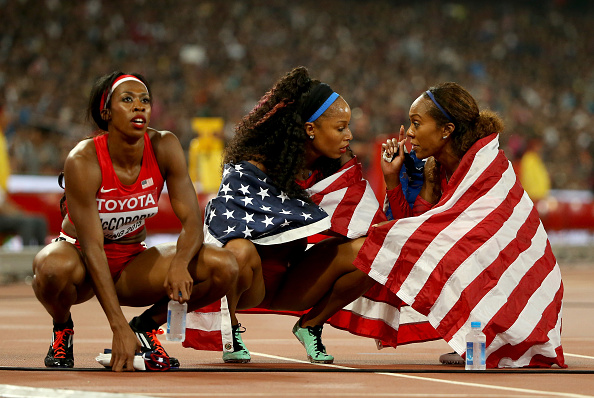 After the race: McCorory, Hastings, Felix // Getty Images