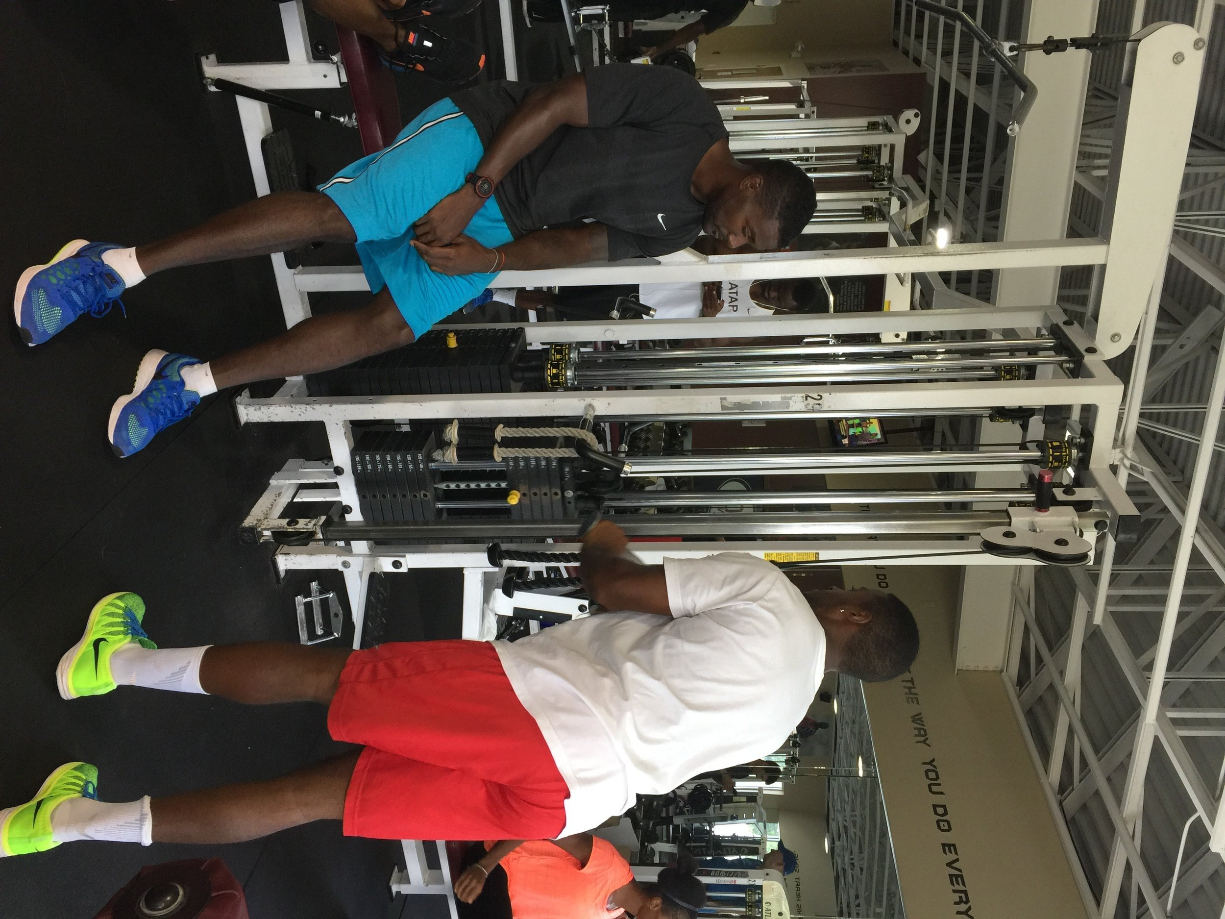 Gatlin, left, lifting weights with Isiah Young
