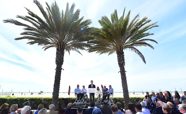 The scene at Santa Monica beach, LA mayor Eric Garcetti at the mike // Getty Images