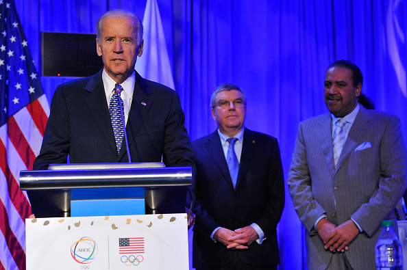 U.S. vice president Joe Biden on the final day of the ANOC session, with Bach and the sheikh looking on // Getty Images