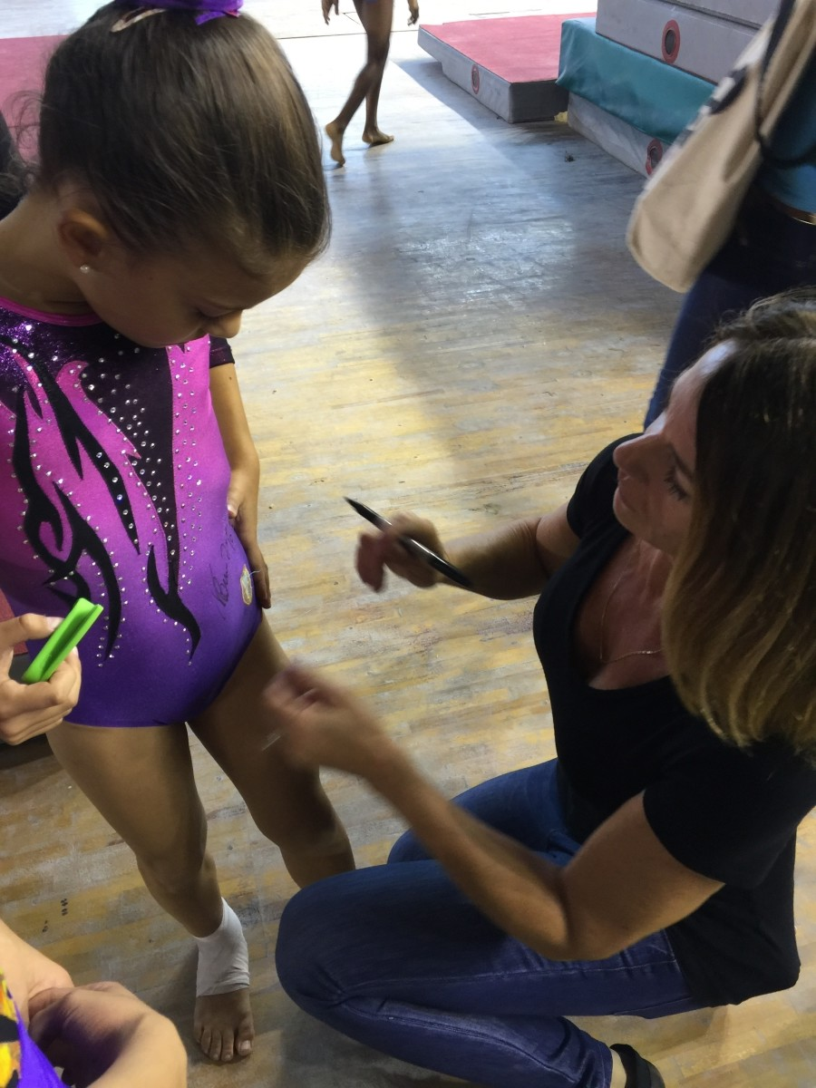 Or you get the double score of having Nadia autograph your leotard