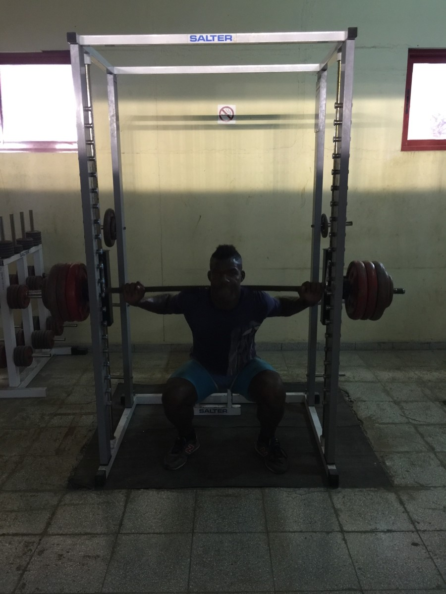 At the squat rack, in a small room where the winter sun provides the only light