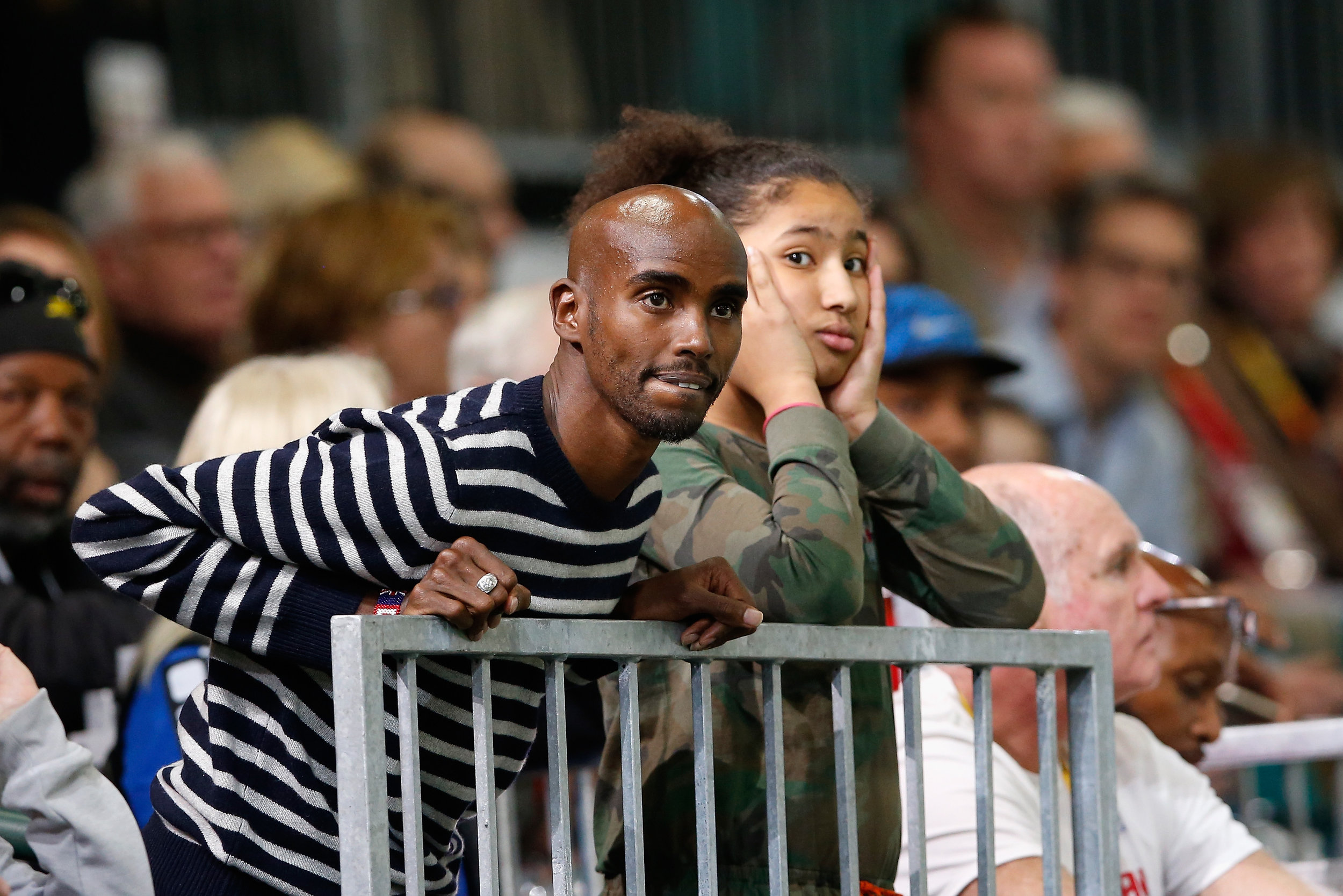 British distance champion Mo Farah, who often trains in the Portland area, watching Friday night's men's 1500 heats with daughter Rihanna // Getty Images for IAAF