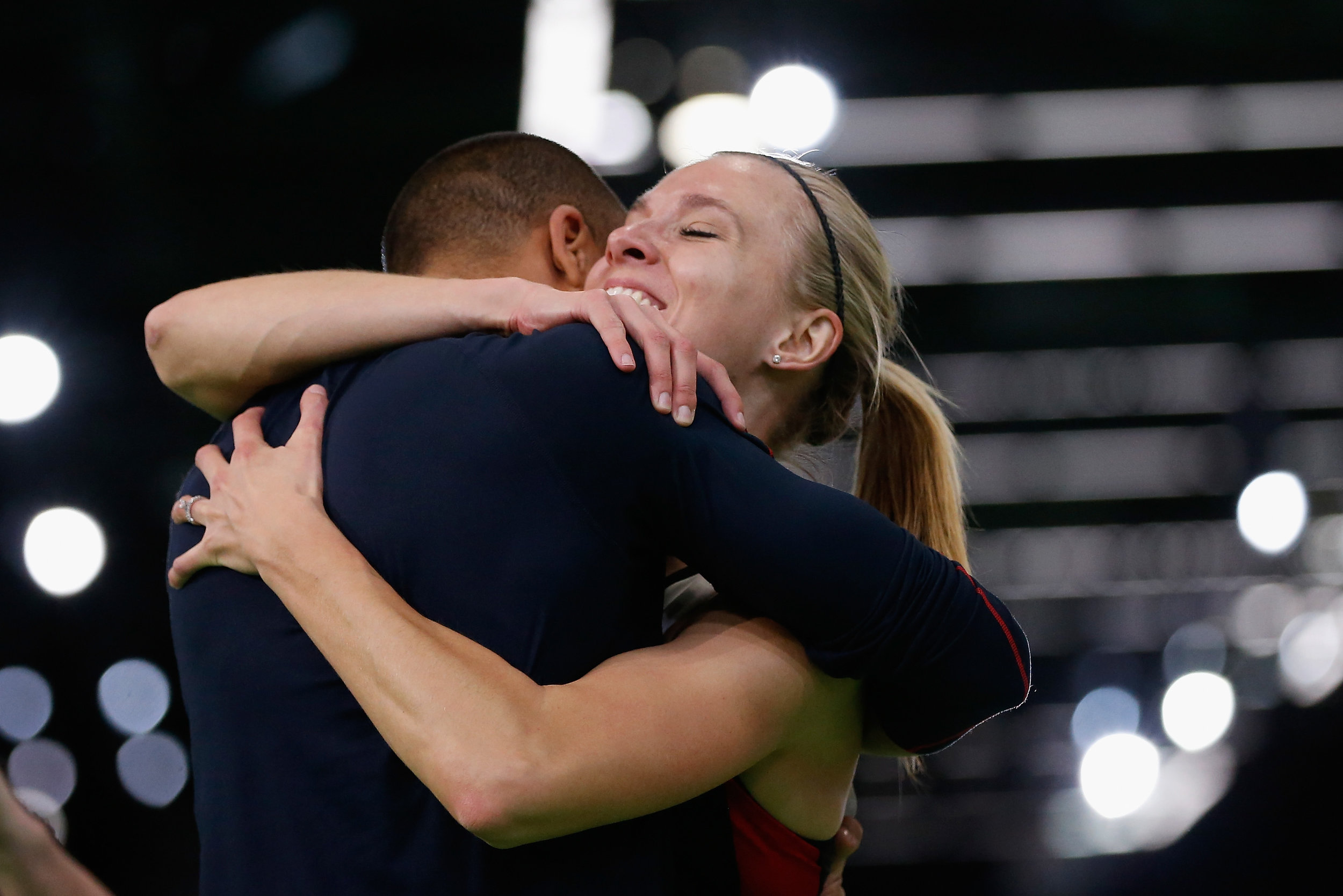 Brianne Theisen-Eaton gets a big hug from husband Ashton Eaton moments after she is announced as pentathlon winner // Getty Images for IAAF)""