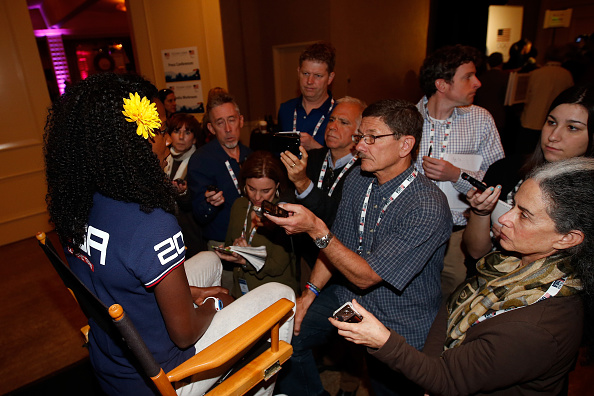 Alysia Montaño surrounded by reporters at the USOC media summit // photo Getty Images