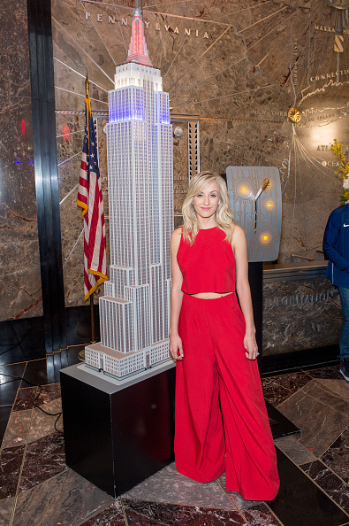 Beijing 2008 gymnastics gold medalist Nastia Liukin on scene as U.S. athletes light the Empire State Building red, white and blue // Getty Images