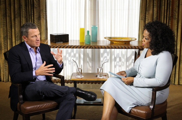 Lance Armstrong, left, with Oprah Winfrey in January 2013 // Getty Images