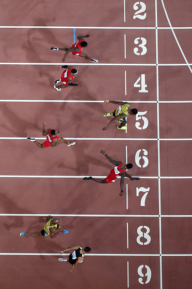 A stumble about 20 meters out cost Gatlin the race, with Bolt, Lane 5, winning by one-hundredth of a second // Getty Images