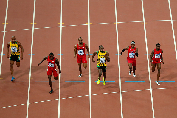 Midway through the race, Justin Gatlin had the lead in the 2015 worlds 100 over Usain Bolt, in yellow jersey // Getty Images