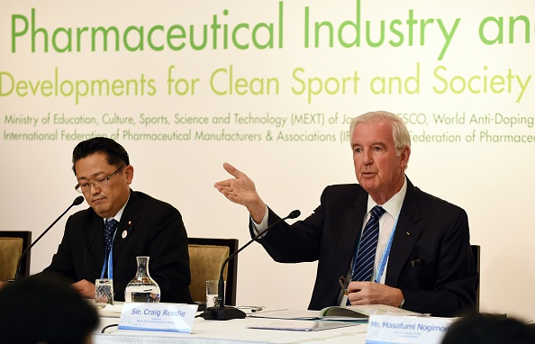 WADA president Sir Craig Reedie, right, speaks beside Japanese deputy Education, Culture, Sports and Science Minister Hideki Niwa during a 2015 news conference // Getty Images