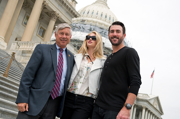 Left to right, in May at the U.S. Capitol: Michigan congressman Fred Upton; his niece, model Kate Upton; and her fiancee, Detroit Tigers pitcher Justin Verlander // Getty Images via Tom Williams/CQ Roll Call)