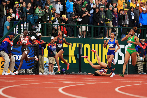 Just after the finish in the 200: Tori Bowie, left, is the winner; Jenna Prandini, on the ground, is third; Allyson Felix, in blue, fourth; Deajah Stevens, right in green, second // Getty Images