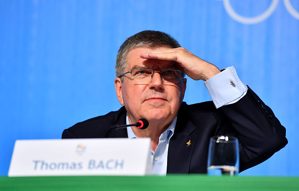 The IOC president. Thomas Bach, at Sunday's news conference and, snark aside, he is looking out through the lights to try to see who is asking him what // Getty Images