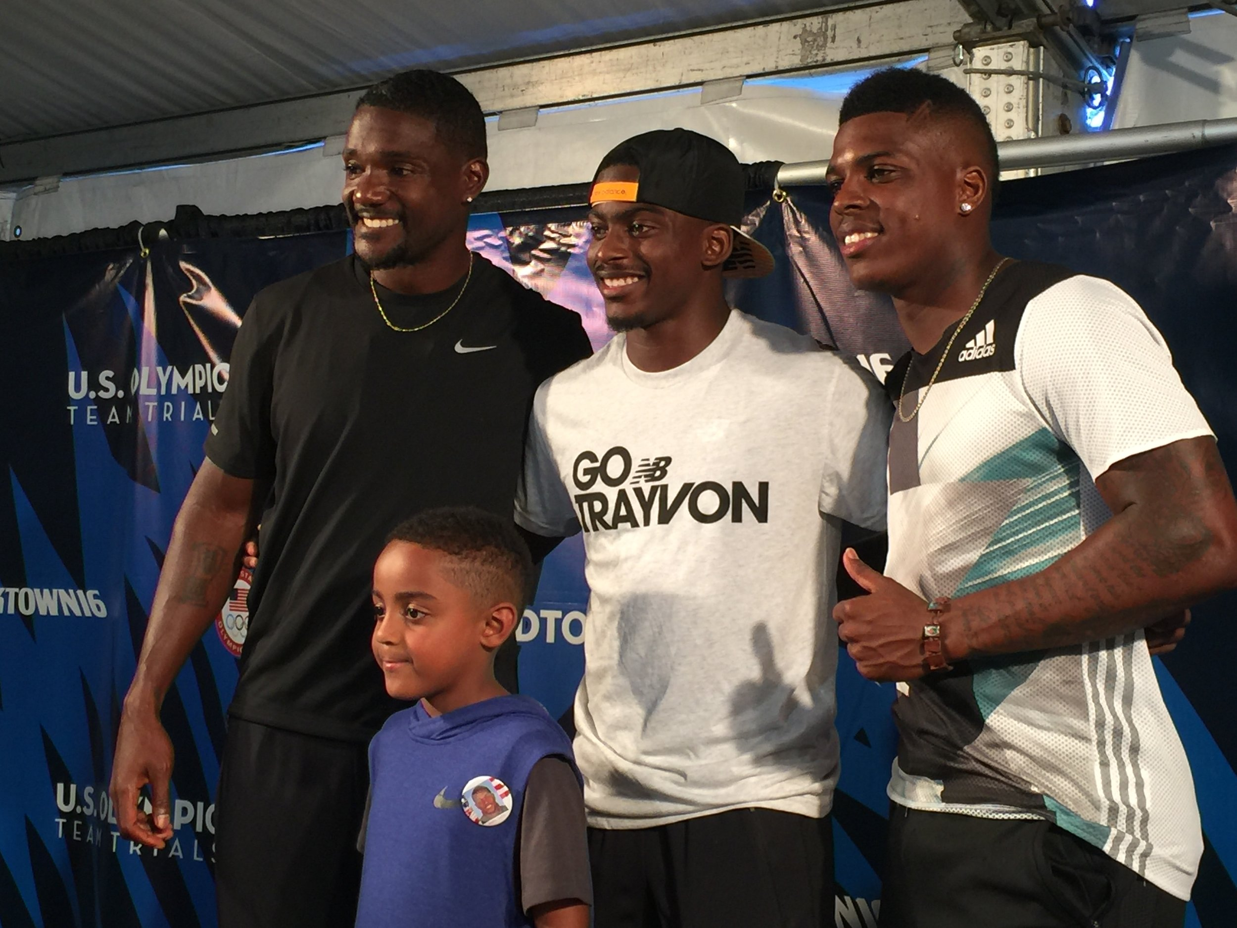 Justin and Jace Gatlin, Trayvon Bromell and Marvin Bracy after the race
