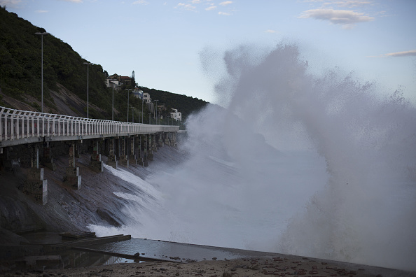 Waves battering the incline near the collapsed bike path // Getty Images