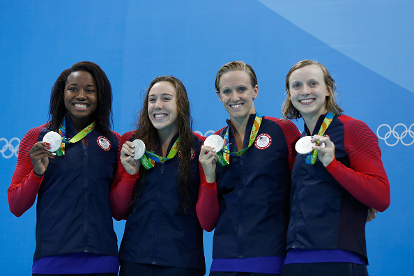 Katie Ledecky, right, with, from left, Simone Manuel, Abbey Weitzeil, Dana Vollmer after Sunday's women's 4x100 freestyle relay // Getty Images