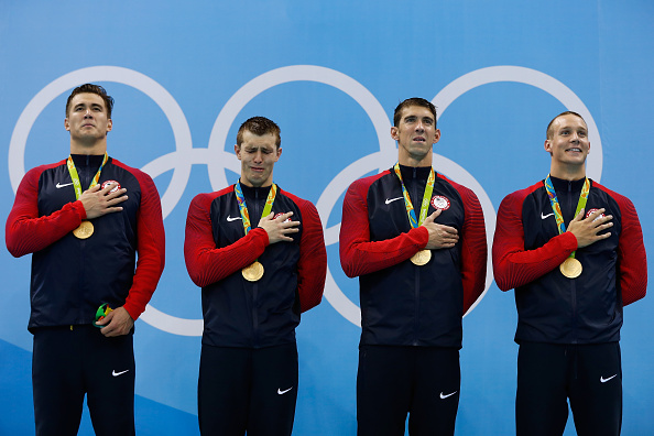 From left, Nathan Adrian, Ryan Held, Michael Phelps and Caeleb Dressel on the medals stand // Getty Images