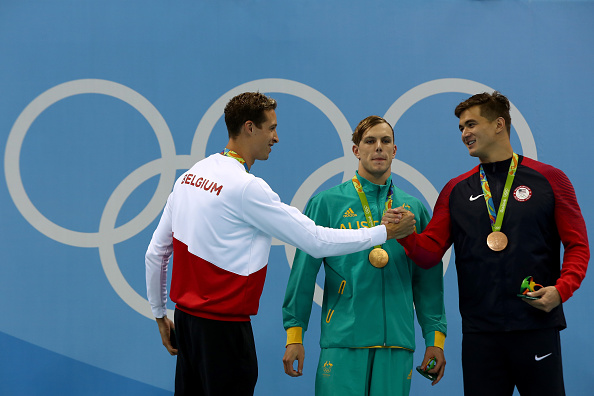 After the men's 100 free: silver medalist Pieter Timmers, left, congratulates bronze medalist Nathan Adrian with winner Kyle Chalmers in the middle // Getty Images