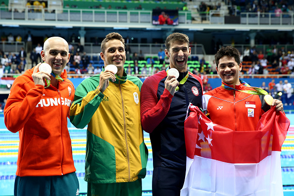 From left, 100 fly silver medalists Laszlo Cseh of Hungary, Chad le Clos of South Africa and Michael Phelps, with gold medalist Joe Schooling of Singapore // Getty Images