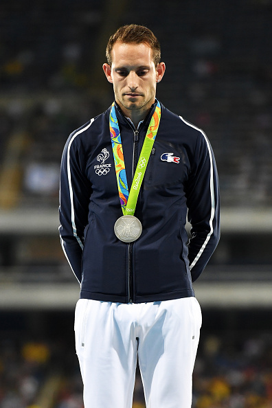 Pole vault silver medalist Renaud Lavillenie on the medals stand // Getty Images