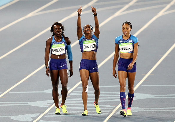 Morolake Akinosun, English Gardner and Allyson Felix after qualifying in the re-run // Getty Images