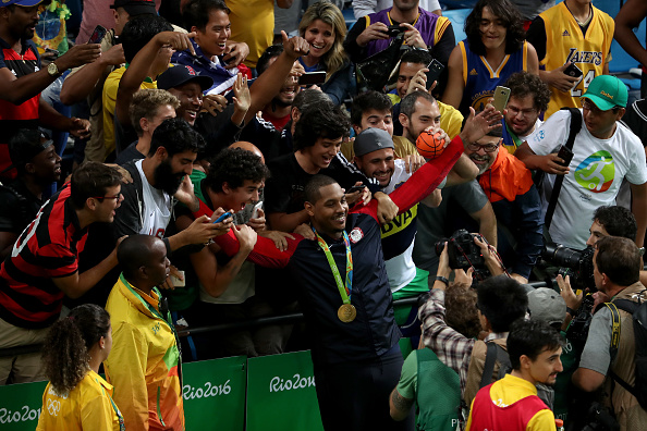 Gold medalist Carmelo Anthony celebrates with the crowd after the U.S. men's 96-66 victory over Serbia // Getty Images