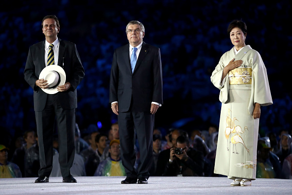 IOC president Thomas Bach, center, with Rio mayor Eduardo Paes and Tokyo governor Yuriko Koike at the Aug. 21 Olympic closing ceremony // Getty Images