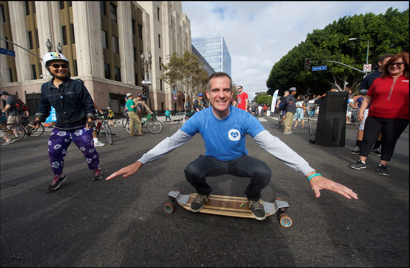Mayor Eric Garcetti at a recent event, the LA Times building in the background // Gary Leonard