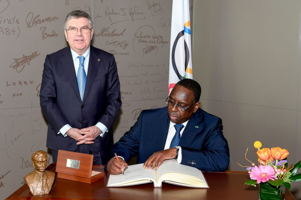 This job would age anyone. IOC president Thomas Bach, left, this week at headquarters in Lausanne, Switzerland, with Macky Sall, president of Senegal // IOC