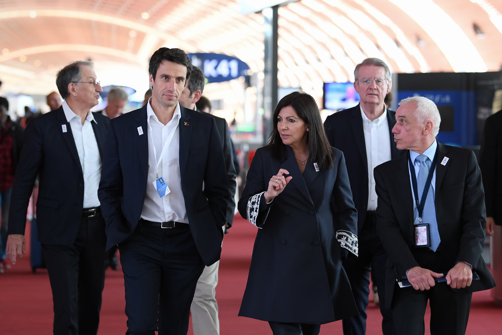 Paris mayor Anne Hidalgo with, among others, bid co-president Tony Estanguet, left, at Charles de Gaulle airport on Saturday, welcoming the IOC evaluation commission to town // Philippe Millereau / KMSP / Paris 2024