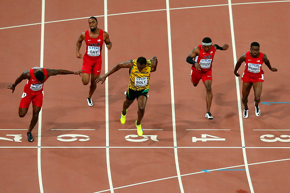 The moment at the finish line at the Beijing 2015 100: Bolt 9.79, Gatlin 9.80 // Getty Images
