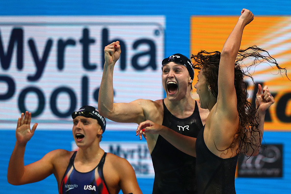 Ledecky, center, celebrating the U.S. 4×1 relay victory // Getty Images