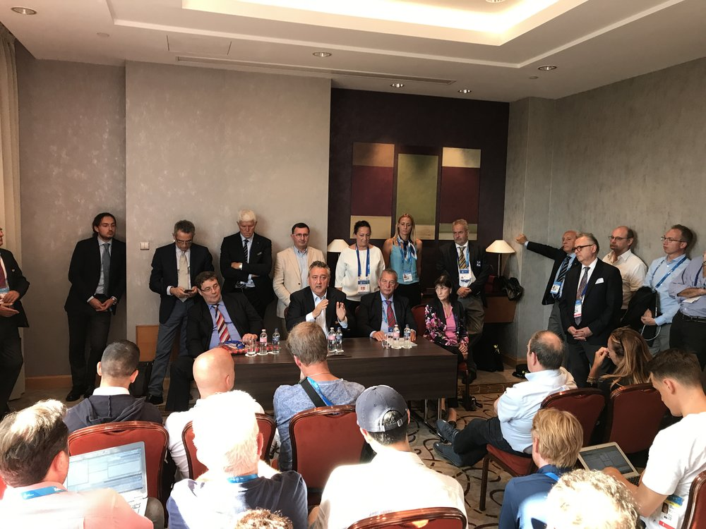 Paolo Barelli of Italy, seated center, at post-election news conference