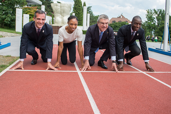 LA mayor Eric Garcetti, Felix, IOC president Thomas Bach, Michael Johnson at the Olympic Museum track // Getty Images