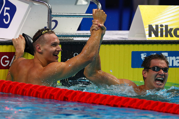 Caeleb Dressel,left, and Nathan Adrian at the end of the men's 100-meter freestyle // Getty Images