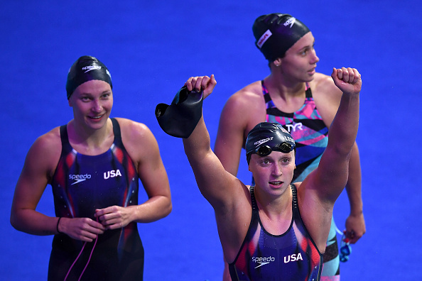 Katie Ledecky, front, after the winning 4×200 free relay // Getty Images